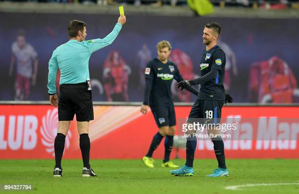 referee Frank Willenborg and Vedad Ibisevic of Hertha BSC during the game between RB Leipzig and Hertha BSC on december 17 2017 in Leipzig Germany