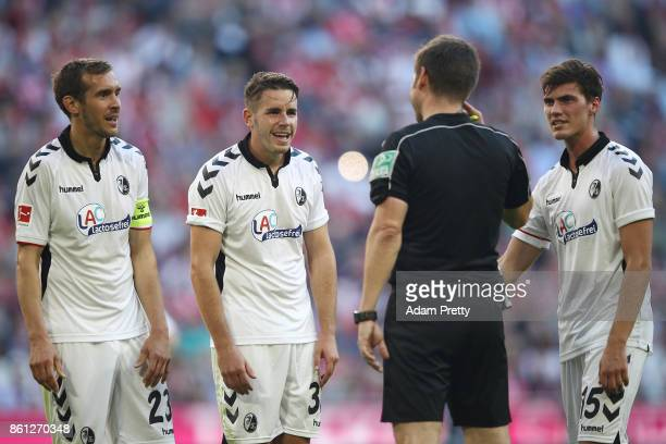 Referee Frank Willenborg argues with players of Freiburg after awarding a penalty to Muenchen during the Bundesliga match between FC Bayern Muenchen...