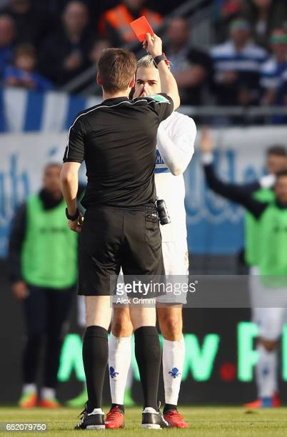 Referee Frank Willenborg shows the red card to Mario Vrancic of Darmstadt during the Bundesliga match between SV Darmstadt 98 and 1 FSV Mainz 05 at...