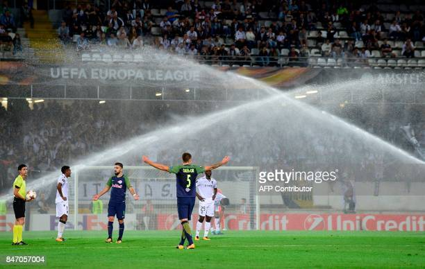Referee from Azrbaijan Aliyar Aghayev stops the game due to the sprinklers activation during the Europa League football match Vitoria Guimaraes SC vs...