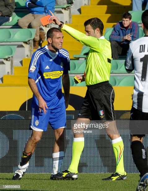 Referee Gabriele Gava shows a red card to Maurizio Lauro of Cesena during the Serie A match between Udinese Calcio and AC Cesena at Stadio Friuli on...
