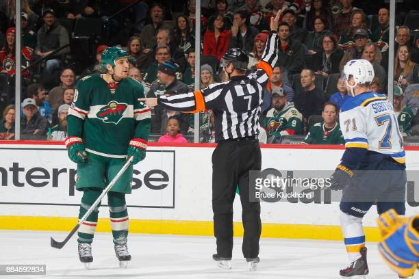 Referee Garrett Rank calls a penalty on Chris Stewart of the Minnesota Wild for roughing Vladimir Sobotka of the St Louis Blues during the game at...