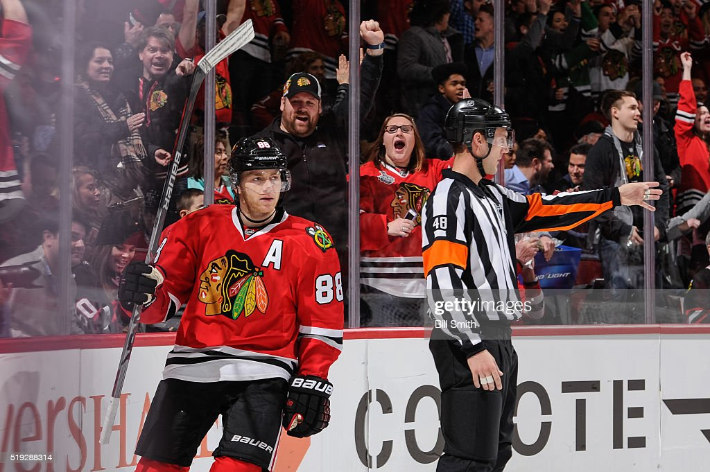 Referee Garrett Rank #48 calls the goal after Patrick Kane #88 of the Chicago Blackhawks scored against the Arizona Coyotes in the second period of the NHL game at the United Center on April 5, 2016 in Chicago, Illinois.