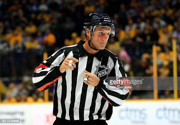 Referee Garrett Rank is shown after sustaining an injury during the NHL game between the Nashville Predators and the Carolina Hurricanes held on...