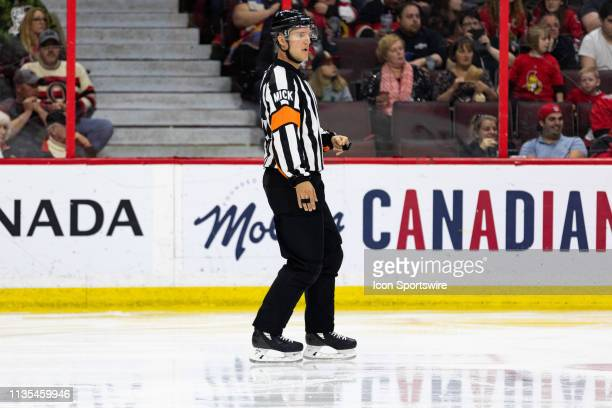 Referee Garrett Rank keeps eyes on the play during second period National Hockey League action between the Columbus Blue Jackets and Ottawa Senators...