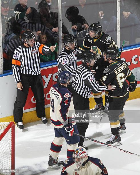 Referee Garrett Rank sends Ryan Rupert of the London Knights to the penalty box against the Saginaw Spirit during an OHL game at the Budweiser...