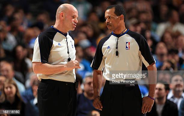 Referee Gary Zielinski and referee Eric Lewis talk during a break in the action as the Oklahoma City Thunder face the Denver Nuggets at the Pepsi...
