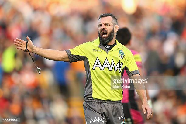 Referee Gavin Badger gives a penalty during the round 16 NRL match between the Wests Tigers and the Penrith Panthers at Leichhardt Oval on June 28...