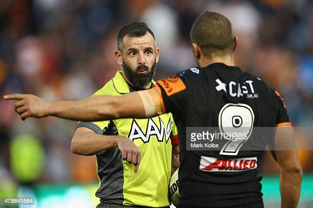 Referee Gavin Badger speaks to Robbie Farah of the Wests Tigers during the round 16 NRL match between the Wests Tigers and the Penrith Panthers at...