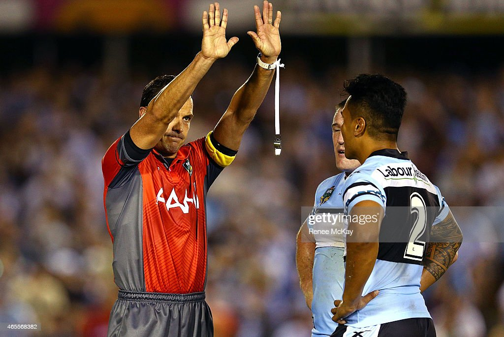 Referee Gavin Morris sends Sosaia Feki of the Sharks to the sin bin for throwing a punch during the round one NRL match between the Cronulla Sharks and the Canberra Raiders at Remondis Stadium on March 8, 2015 in Sydney, Australia.