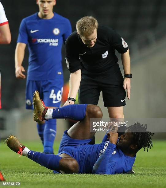 Referee Gavin Ward looks on as Michy Batshuayi of Chelsea lays injured during the Checkatrade Trophy Second Round match between Milton Keynes Dons...
