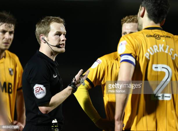 Referee Gavin Ward make a point to Ben Purkiss of Port Vale during the Sky Bet League One match between Northampton Town and Port Vale at Sixfields...