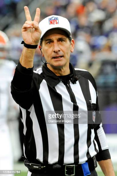 Referee Gene Steratore announces a penalty in the second quarter of a game between the Cleveland Browns and Baltimore Ravens at M&T Bank Stadium on...