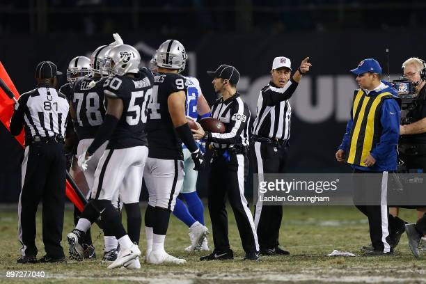 Referee Gene Steratore calls first down to Dallas during the game against the Oakland Raiders at Oakland-Alameda County Coliseum on December 17, 2017...