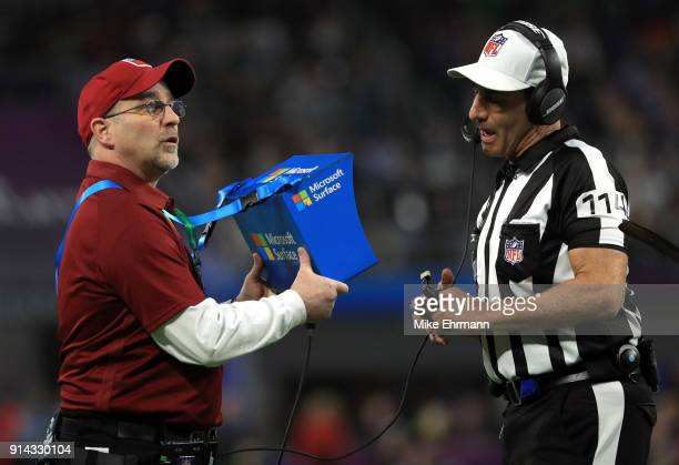 Referee Gene Steratore checks the replay of the Philadelphia Eagles touchdown against the New England Patriots during the third quarter in Super Bowl...