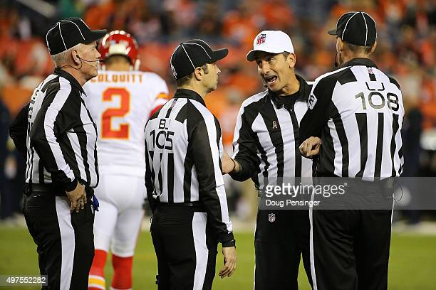 Referee Gene Steratore consults with his squad, field judge Bob Waggoner, back judge Dino Paganelli and line judge Gary Arthur, as the over see the...