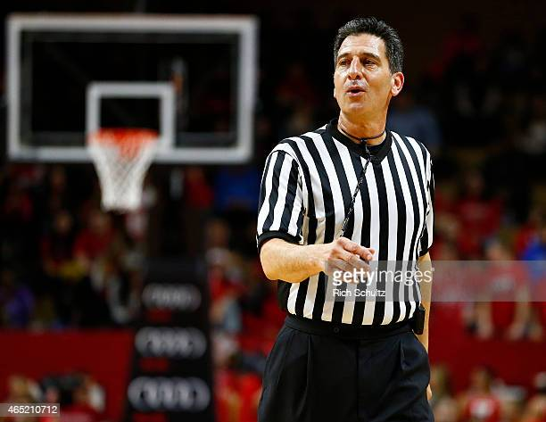 Referee Gene Steratore gestures during a college basketball game between the Maryland Terrapins and Rutgers Scarlet Knights at the Rutgers Athletic...