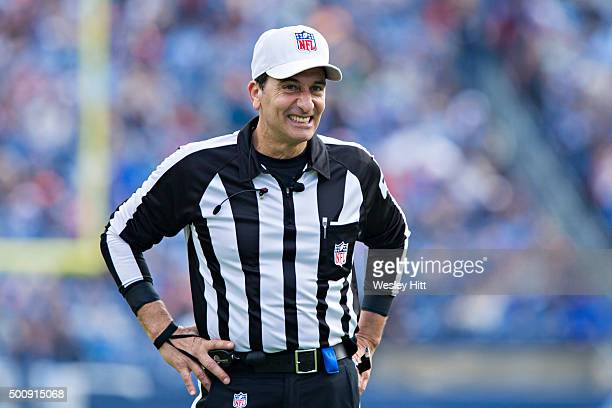 Referee Gene Steratore jokes with the fans during a game between the Jacksonville Jaguars and the Tennessee Titans at Nissan Stadium on December 6,...