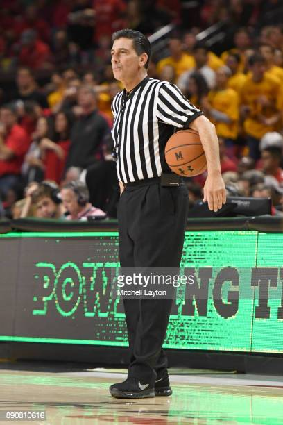 Referee Gene Steratore looks on during a college basketball game between the Purdue Boilermakers and the Maryland Terrapins at the Xfinity Center on...