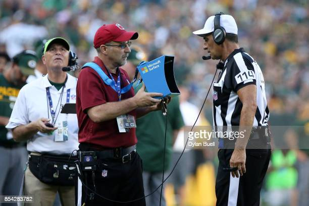 Referee Gene Steratore looks on during a video review during the game between the Green Bay Packers and the Cincinnati Bengals at Lambeau Field on...