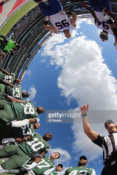 Referee Gene Steratore performs the coin toss with the captains of the New York Jets and the Buffalo Bills at MetLife Stadium on October 26, 2014 in...
