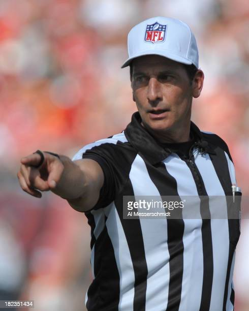 Referee Gene Steratore points to the spot of a penalty as the Tampa Bay Buccaneers play against the Arizona Cardinals September 29, 2013 at Raymond...