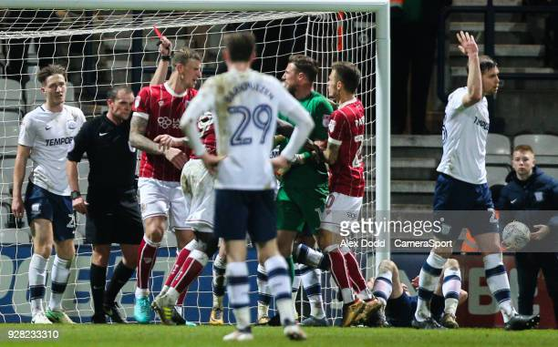 Referee Geoff Eltringham shows Bristol City's Aden Flint the red card during the Sky Bet Championship match between Preston North End and Bristol...