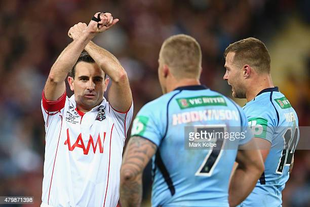Referee Gerard Sutton places Trent Hodkinson and Trent Merrin of the Blues on report for a dangerus tackle during game three of the State of Origin...