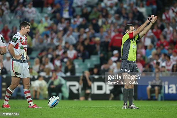 Referee Gerard Sutton points to the goals as Gareth Widdop of the Dragons decides to kick for goal against the Roosters during their ANZAC day clash...