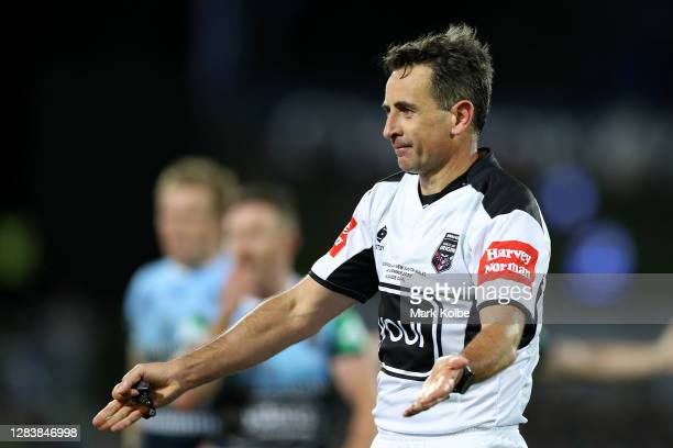 Referee Gerard Sutton signals during game one of the 2020 State of Origin series between the Queensland Maroons and the New South Wales Blues at the...