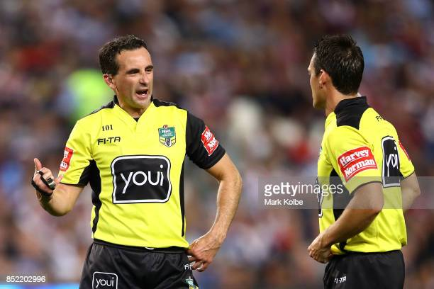 Referee Gerard Sutton speaks to assistant referee Adam Gee during the NRL Preliminary Final match between the Sydney Roosters and the North...
