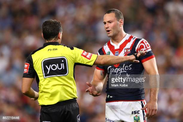 Referee Gerard Sutton speaks to Boyd Cordner of the Roosters during the NRL Preliminary Final match between the Sydney Roosters and the North...