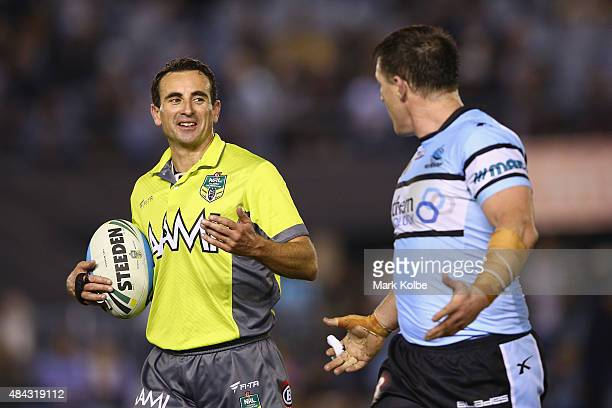 Referee Gerard Sutton speaks to Paul Gallen of the Sharks during the round 23 NRL match between the Cronulla Sharks and the Melbourne Storm at...