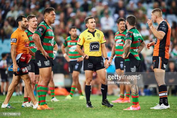 Referee Gerard Sutton speaks to players during the round six NRL match between the South Sydney Rabbitohs and the Wests Tigers at Stadium Australia,...