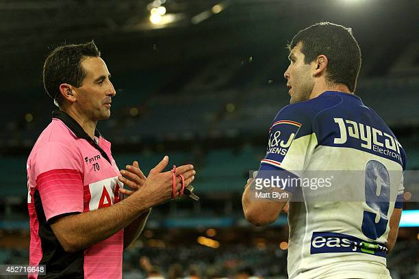 Referee Gerard Sutton talks to Bulldogs captain Michael Ennis during the round 20 NRL match between the Canterbury Bulldogs and the North Queensland...
