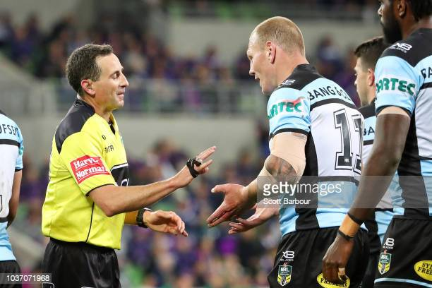 Referee Gerard Sutton talks to Luke Lewis of the Sharks during the NRL Preliminary Final match between the Melbourne Storm and the Cronulla Sharks at...