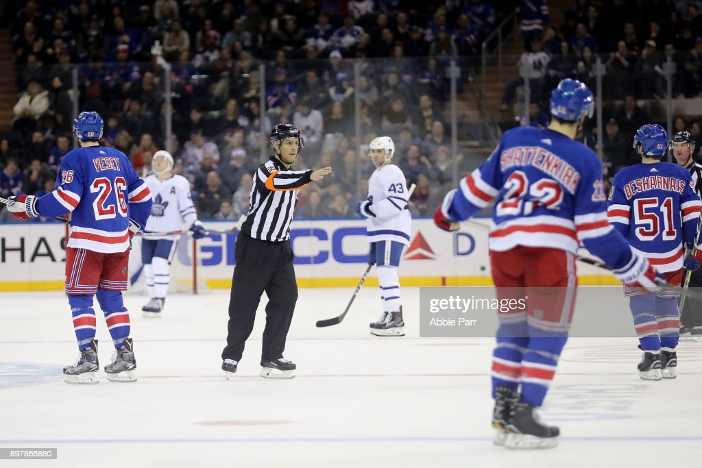 Referee Ghislain Hebert makes a call in a game full of many calls between the New York Rangers and Toronto Maple Leafs during their game at Madison Square Garden on December 23, 2017 in New York City.