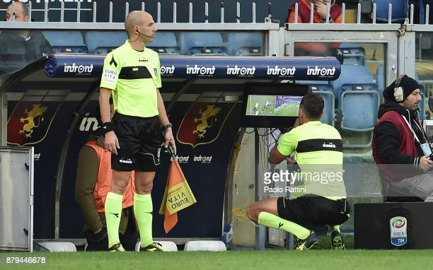 Referee Giacomelli checks the VAR during the Serie A match between Genoa CFC and AS Roma at Stadio Luigi Ferraris on November 26 2017 in Genoa Italy