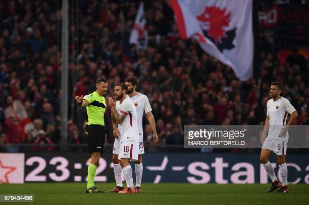 Referee Giacomelli gives red card to AS Roma's midfielder Daniele De Rossi during the Italian Serie A football match Genoa Vs AS Roma on November 26...