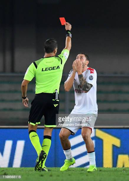 Referee Gianluca Manganello shows the red card to Davide Calabria of AC Milan during the Serie A match between Hellas Verona and AC Milan at Stadio...