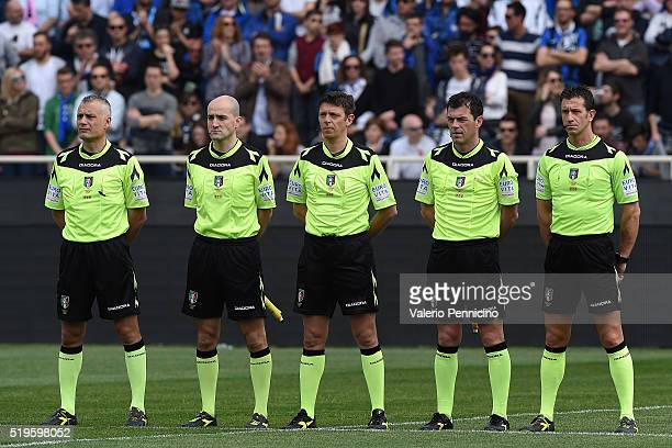Referee Gianluca Rocchi and his assistants stand for a minutes silence for the death of Cesare Maldini during the Serie A match between Atalanta BC...