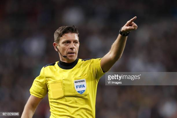 referee Gianluca Rocchi during the UEFA Champions League round of 16 match between Real Madrid and Paris SaintGermain at the Santiago Bernabeu...