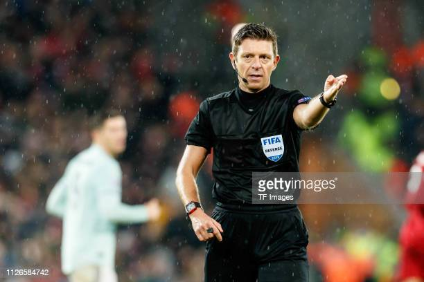 referee Gianluca Rocchi gestures during the UEFA Champions League Round of 16 First Leg match between Liverpool and FC Bayern Muenchen at Anfield on...