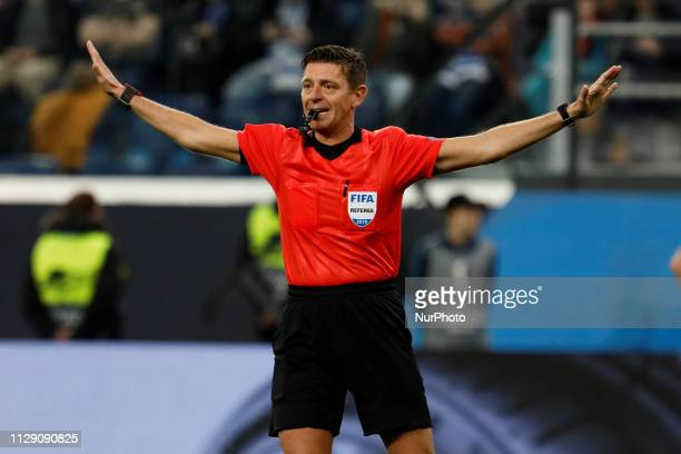 Referee Gianluca Rocchi gestures during the UEFA Europa League Round of 16 first leg match between FC Zenit Saint Petersburg and Villarreal CF on...