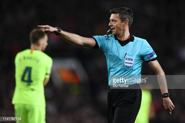 Referee Gianluca Rocchi gives instru during the UEFA Champions League Quarter Final first leg match between Manchester United and FC Barcelona at Old...
