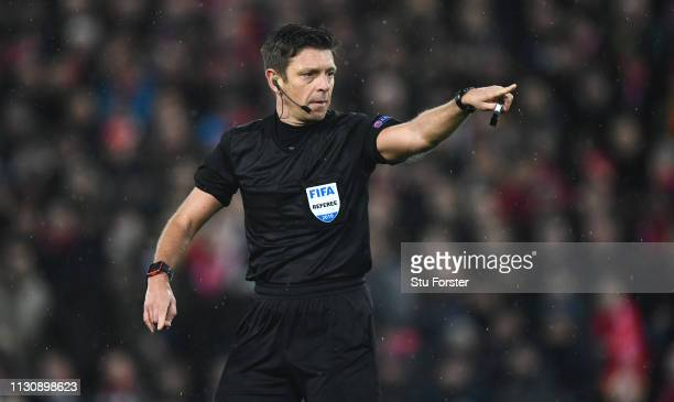 Referee Gianluca Rocchi in action during the UEFA Champions League Round of 16 First Leg match between Liverpool and FC Bayern Munich at Anfield on...