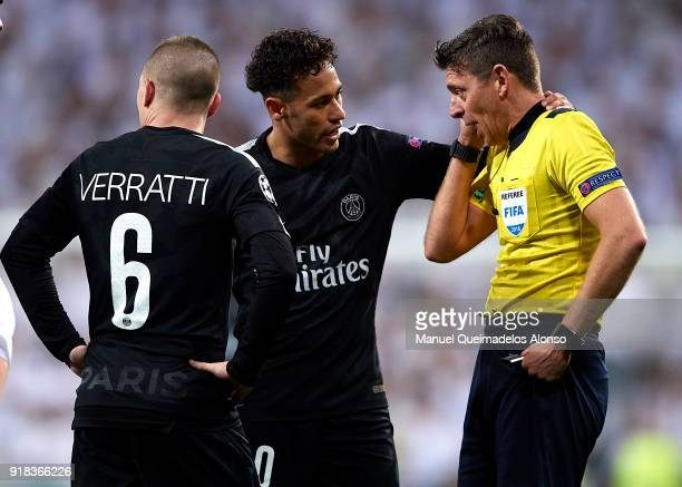 Referee Gianluca Rocchi is conforted by Neymar of Paris SaintGermain during the UEFA Champions League Round of 16 First Leg match between Real Madrid...