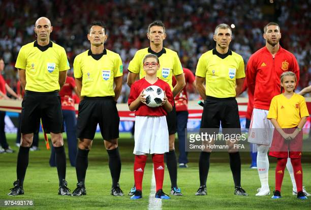 Referee Gianluca Rocchi lines up with fellow match officials and mascots ahead of the 2018 FIFA World Cup Russia group B match between Portugal and...