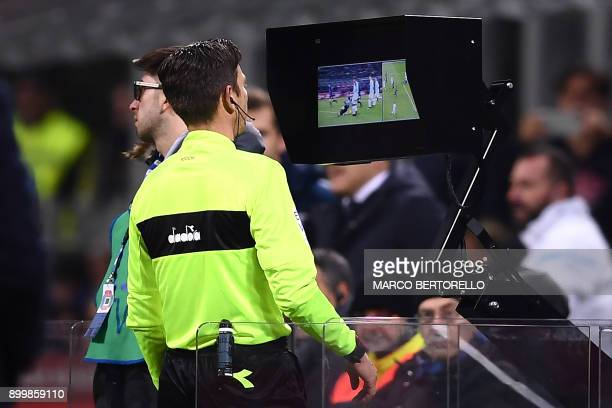 Referee Gianluca Rocchi looks at the screen of the Video Assistant Referee system during the Italian Serie A football match Inter Milan Vs Lazio on...