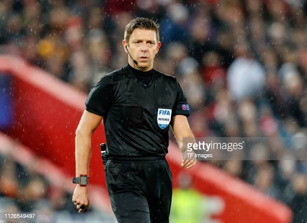 referee Gianluca Rocchi looks on during the UEFA Champions League Round of 16 First Leg match between Liverpool and FC Bayern Muenchen at Anfield on...